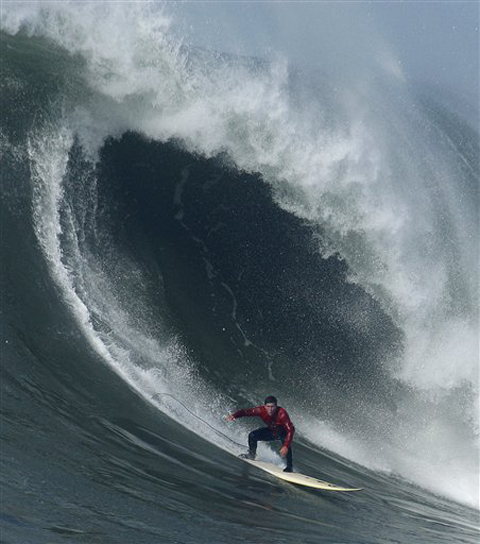 Chris Bertish - winner of the 2010 Mavericks Surf Contest - slides into a macker