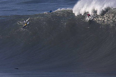 Unknown contestant drops into a very big wave at the Mavericks Surf Contest