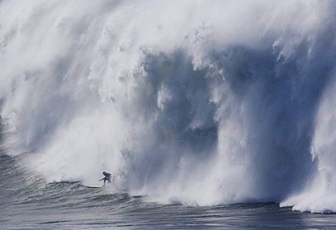 An unknown contestant tried to out run the Pacific Ocean dumping on his back